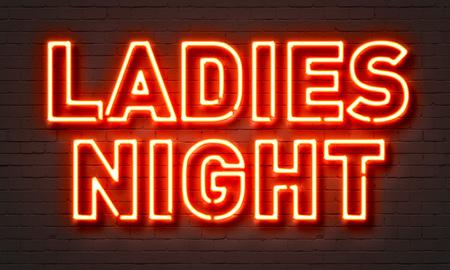 Ladies night neon sign on brick wall background