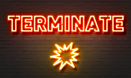 terminate: Terminate neon sign on brick wall background