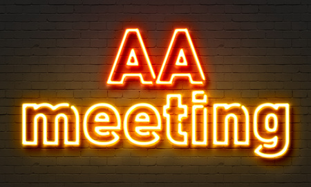 AA meeting neon sign on brick wall background