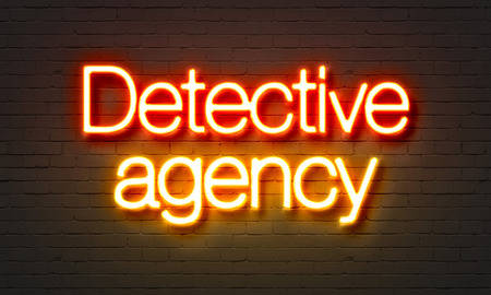 crime solving: Detective agency neon sign on brick wall background