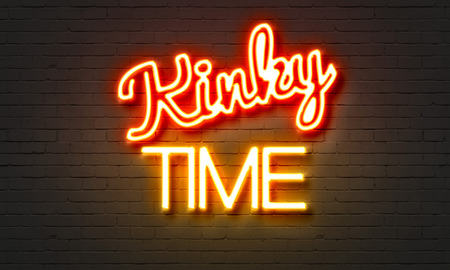Kinky time neon sign on brick wall background Stock Photo