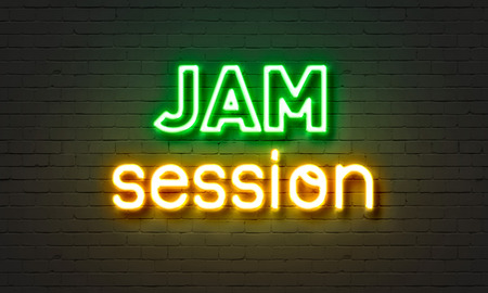 Jam session neon sign on brick wall background