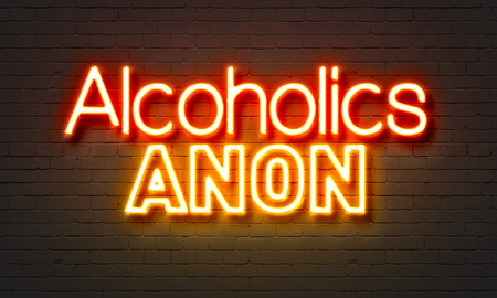 anon: Alcoholics anon neon sign on brick wall background