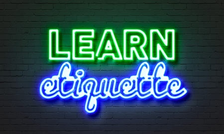 Learn etiquette neon sign on brick wall background Standard-Bild