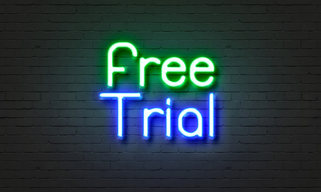 Free trial neon sign on brick wall background
