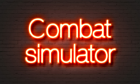 simulator: Combat simulator neon sign on brick wall background Stock Photo