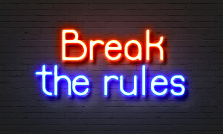 subversive: Break the rules neon sign on brick wall background