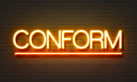 conform: Conform neon sign on brick wall background