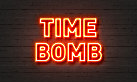 defuse: Time bomb neon sign on brick wall background Stock Photo
