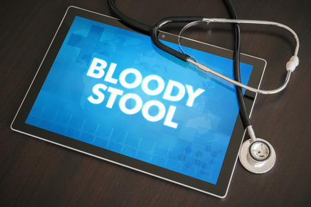 Bloody stool (gastrointestinal disease related) diagnosis medical concept on tablet screen with stethoscope.