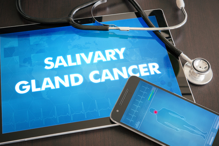 salivary: Salivary gland cancer (cancer type) diagnosis medical concept on tablet screen with stethoscope.