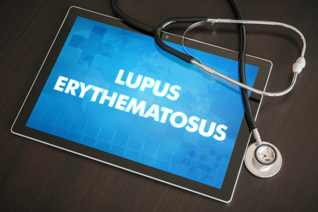 Lupus erythematosus (cutaneous disease) diagnosis medical concept on tablet screen with stethoscope.