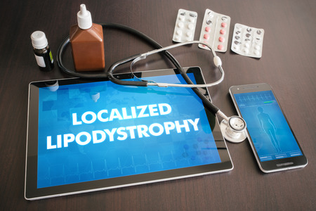 Localized lipodystrophy (cutaneous disease) diagnosis medical concept on tablet screen with stethoscope. Stock fotó
