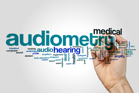 Audiometry word cloud concept on grey background. Foto de archivo