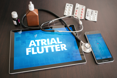 Atrial flutter (heart disorder) diagnosis medical concept on tablet screen with stethoscope.