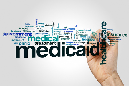 Medicaid word cloud concept on grey background Stock Photo