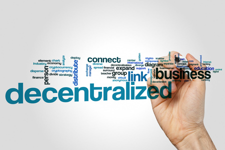 decentralized: Decentralized word cloud concept on grey background. Stock Photo