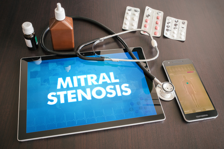 stenosis: Mitral stenosis (heart disorder) diagnosis medical concept on tablet screen with stethoscope. Stock Photo