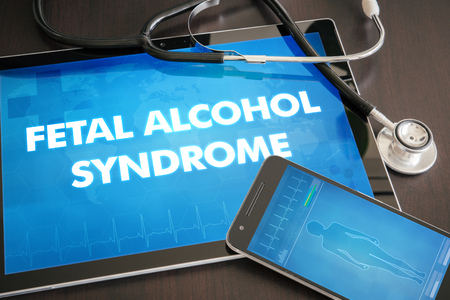 Fetal alcohol syndrome (congenital disorder) diagnosis medical concept on tablet screen with stethoscope. Stock Photo