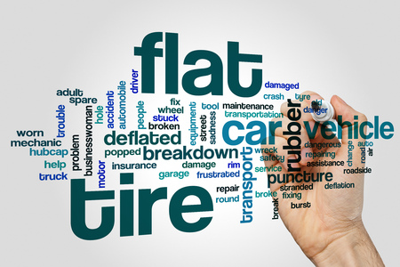 Flat tire word cloud concept on grey background. Banco de Imagens