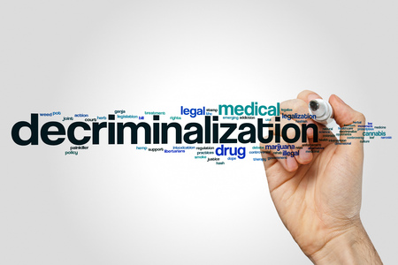 Decriminalization word cloud concept on grey background.