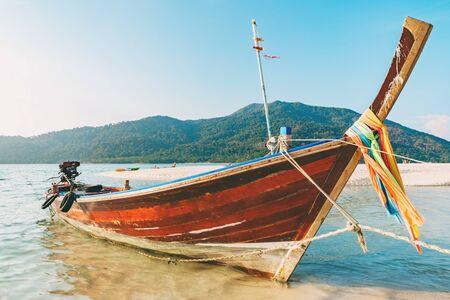 Long tail boat on white sand beach on tropical island, Koh Lipe, Andaman sea, Thailand Фото со стока