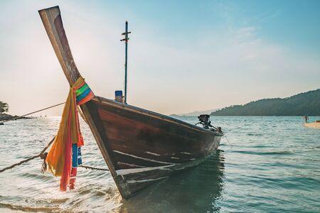 Long tail boat on white sand beach on tropical island, Koh Lipe, Andaman sea, Thailand Stock Photo