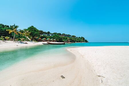 Beautiful sandy tropical beach in Koh Lipe, Thailand with pristine white sand, palm trees and a sparkling blue ocean in a travel concept