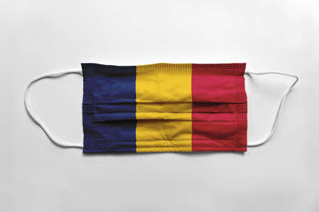 Face mask with Chad flag printed, on white background, isolated.