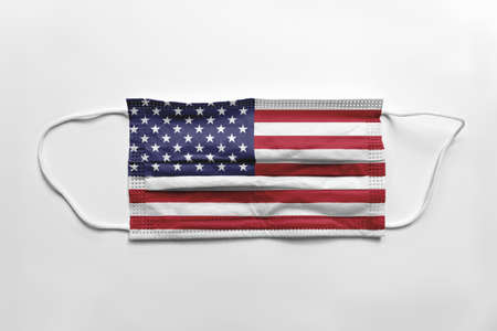 Face mask with United States of America flag printed, on white background, isolated.