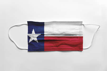Face mask with Texas flag printed, on white background, isolated safety concept