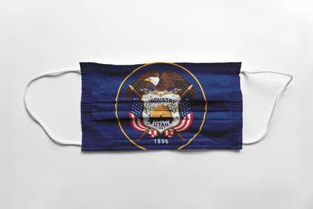 Face mask with Utah flag printed, on white background, isolated safety concept