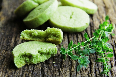Green, biscuits with parmesan cheese, thyme and tea match