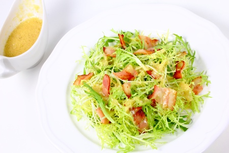 Frieze salad with fried bacon