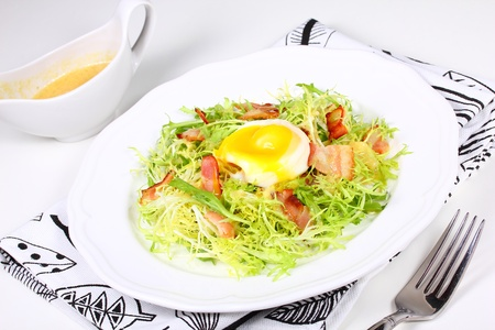 Salad with bacon and eggs poached