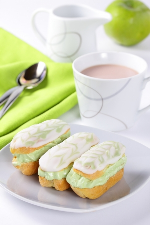 Mini eclairs with pistachio cream  Stock Photo