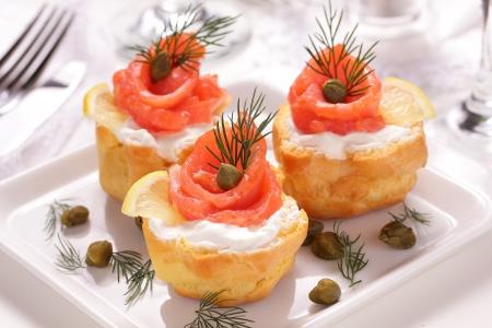 Profiteroles with cream and salmon