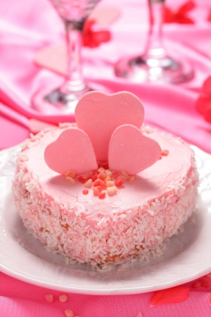 A small cake in the shape of a pink heart   Stock Photo
