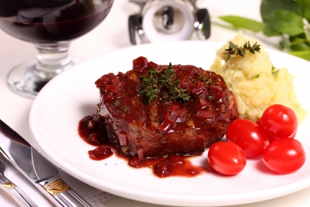 A piece of fillet with vegetables and wine sauce