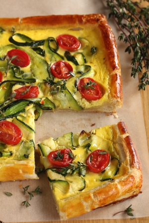 Pie with tomatoes, zucchini and cheese  Stock Photo