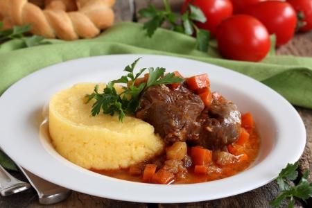Osso Bucco with polenta   Stock Photo