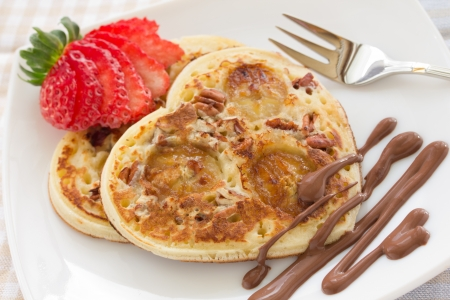 Pancakes with bananas and nuts.