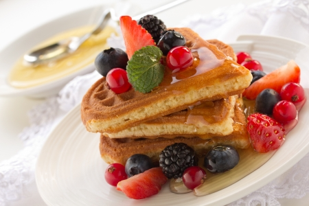 Waffles with honey and berries.