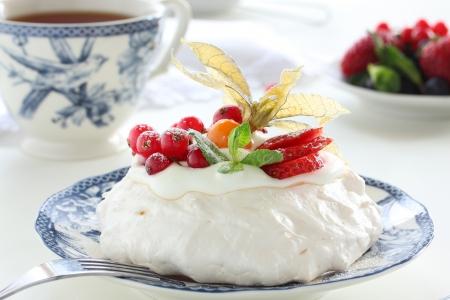 Cake Pavlova with cream and berries.