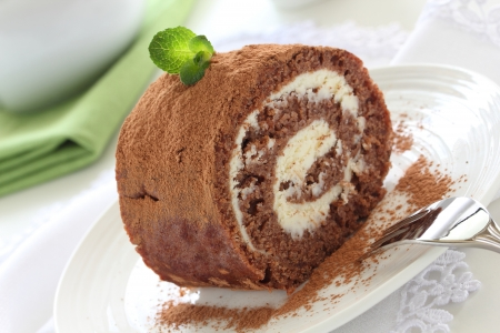 Chocolate roll with cream.
