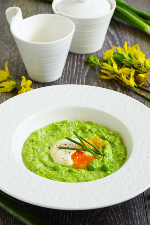 Puree the soup peas with poached egg. Stock Photo