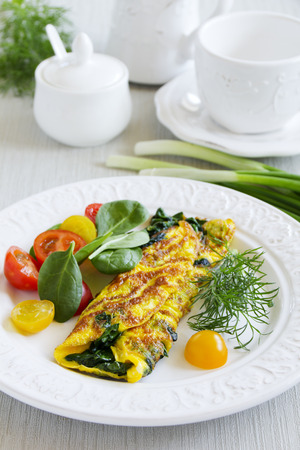 Omelet with spinach and lettuce tomato.
