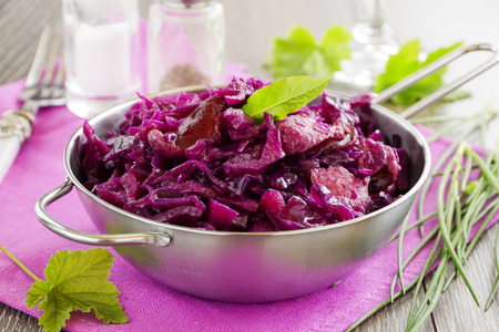 Braised red cabbage with sausages.