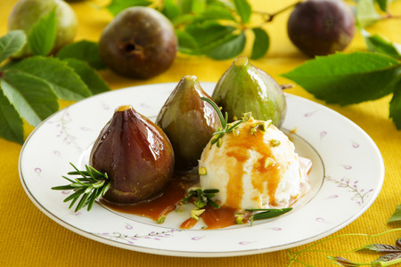 Baked figs with caramel and ice cream. Stock Photo