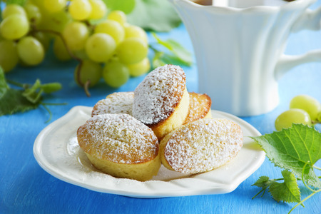 Madeleine cakes with grapes,